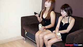 Amateur lesbian Asian MILFs using dildos on eternally others pussy